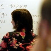 a woman teaching spanish to students in Brooklyn