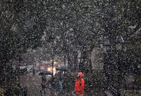 A man standing in the snow in New York City